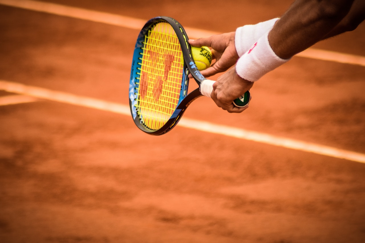 close-up-photo-of-person-holding-tennis-racket-and-ball-1432039 (2)